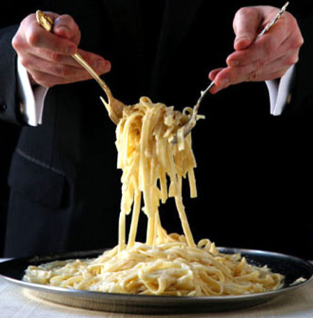 Waiter serving Fettucinni Allfredo